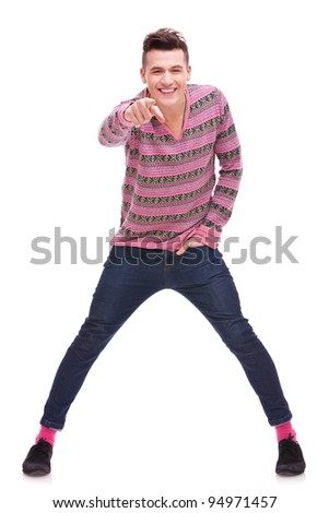 Portrait of a happy young man pointing at the camera over white background . full body picture of an excited young  casual man pointing to the camera - stock photo