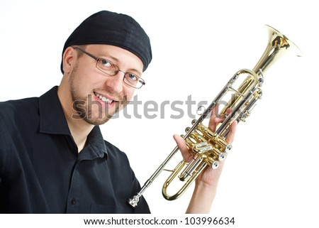 Portrait of a happy young man with cap and glasses, holding a trumpet, smiling into camera - isolated on white - stock photo