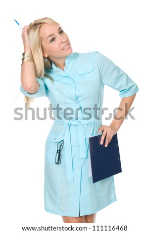 Portrait of a happy young nurse with file folders over white background - stock photo