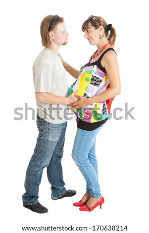 Portrait of a happy young pregnant woman (9 month) with her husband - stock photo