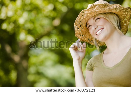 Portrait of a happy young pretty woman smiling - stock photo