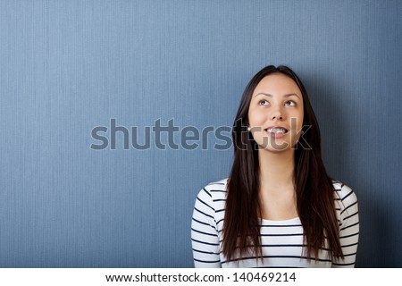 portrait of a happy young woman looking up