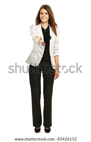 Portrait of a happy young woman offering a handshake against white background
