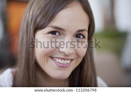 Portrait of a happy young woman smiling