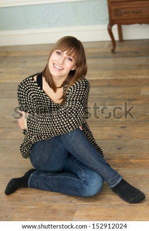 Portrait of a happy young woman smiling at home - stock photo