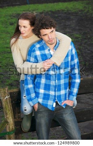 Portrait of a healthy loving couple standing outdoors - stock photo