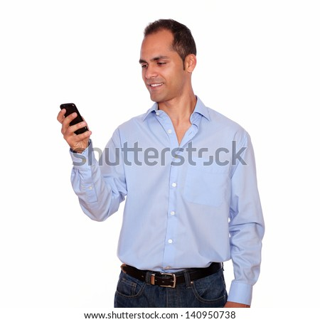 Portrait of a hispanic adult man calling on cellphone over white background