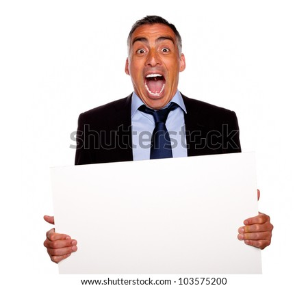 Portrait of a hispanic senior businessman screaming and holding a white card with copyspace on isolated background - stock photo