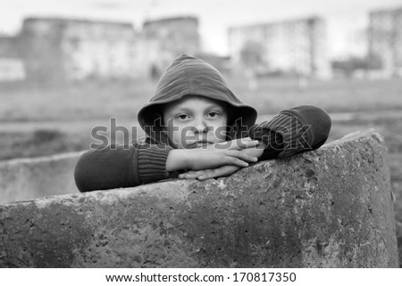 portrait of a homeless young boy - stock photo