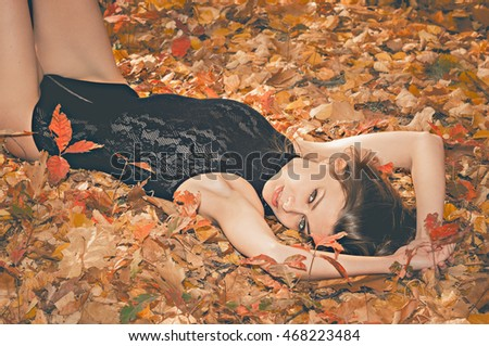 Portrait of a hot young woman in autumn park