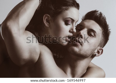 Portrait of a hugging couple .Glamour colors