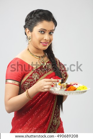 Portrait of a Indian woman holding a puja thali