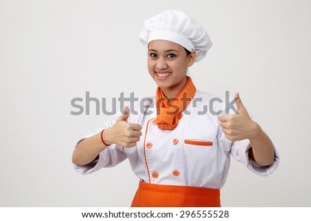 Portrait of a Indian woman with chef uniform - stock photo