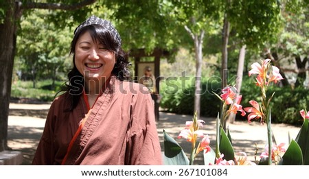 Portrait of a Japanese woman with traditional clothing. - stock photo