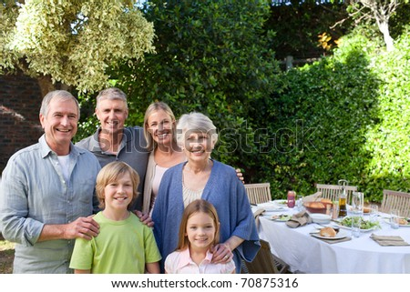 Portrait of a joyful family looking at the camera - stock photo