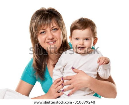 Portrait of a joyful mother and her little daughter in the bed on white background - stock photo