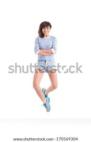 Portrait of a jumping teenage girl - stock photo