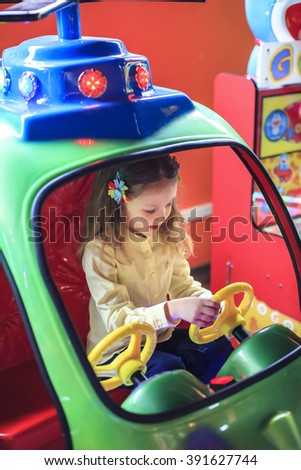 Portrait of a  kid girl playing in a toy helicopter - stock photo