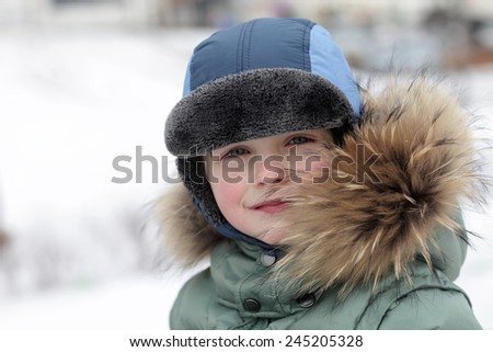 Portrait of a kid in winter park
