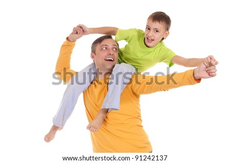 portrait of a kid on his father shoulders