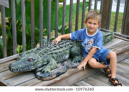 Portrait of a kid with an alligator - stock photo
