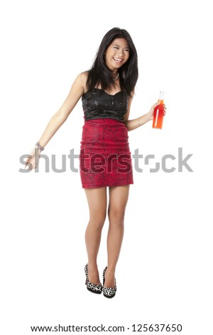 Portrait of a lady dancing while holding a beer over the white background - stock photo