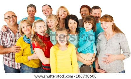Portrait of a large group of a Mixed Age people smiling and embracing together. - stock photo