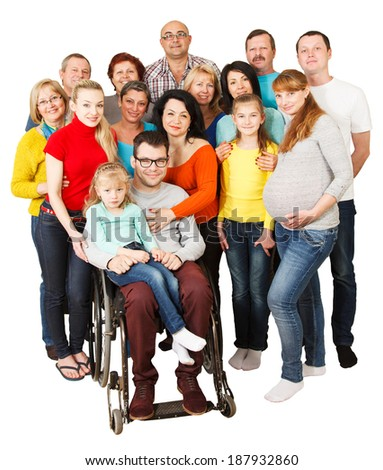 Portrait of a large group of a Mixed Age people smiling and embracing together with Disabled Man.