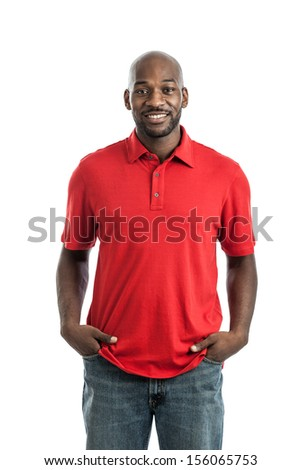 Portrait of a late 20s handsome black casual businessman with hands in pockets isolated on a white background