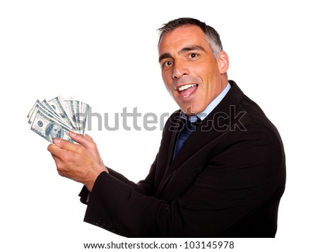 Portrait of a latin executive holding plenty of cash money while show it on isolated background - stock photo
