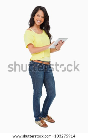 Portrait of a latin student using a touch pad against white background