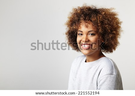 portrait of a latin woman with a curly hair, wearing sweatshirt - stock photo