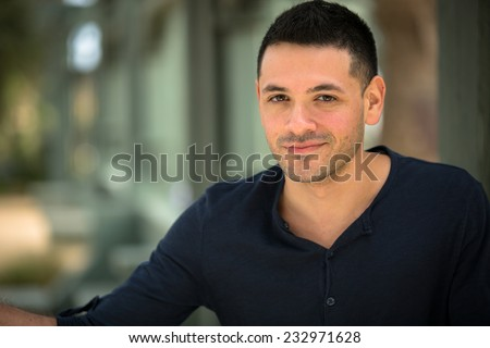 Portrait of a latino young man outside - stock photo