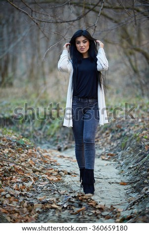 Portrait of a latino young woman outdoor in the woods