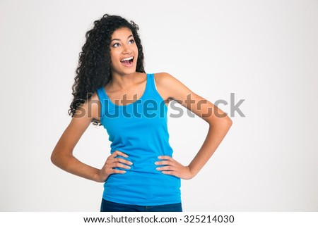 Portrait of a laughing afro american woman looking away at copyspace isolated on a white background - stock photo