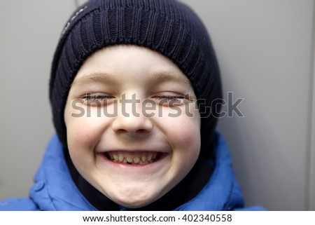 Portrait of a laughing child on the wall background