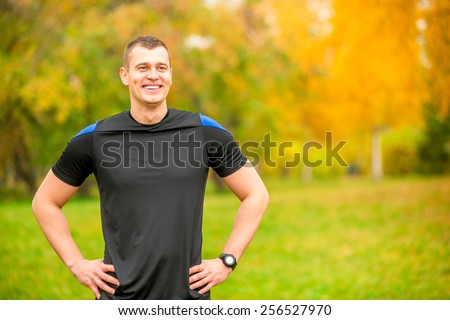 portrait of a laughing trainer in the park - stock photo