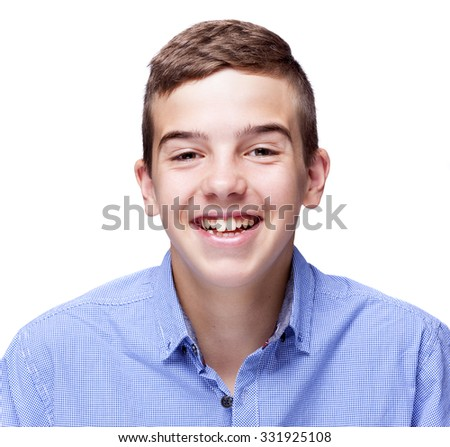 Portrait of a laughing young boy, isolated on white background - stock photo