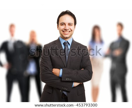 Portrait of a leader in front of his team - stock photo