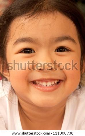 Portrait of a little Asian girl - stock photo