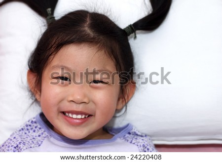 Portrait of a little Asian girl - stock photo