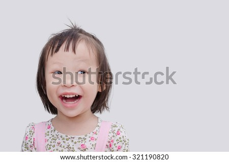 Portrait of a little Asian girl isolated on white background