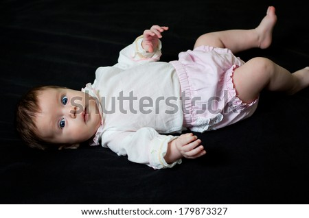 Portrait of a little baby girl with blue eyes