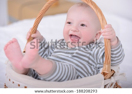 Portrait of a little baby in a basket. Happiness family