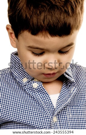portrait of a little boy, a symbol of childhood, insecurity, shyness - stock photo