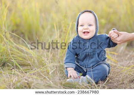 portrait of a little boy in the nature in summer - stock photo