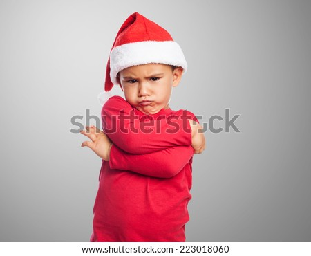 portrait of a little boy on christmas time with angry gesture - stock photo
