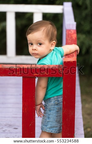 portrait of a little boy on playground. playing child