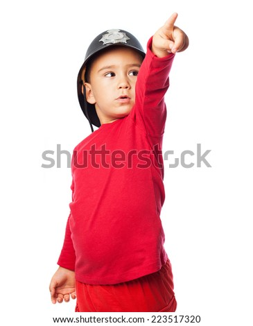portrait of a little boy playing as a firefighter - stock photo