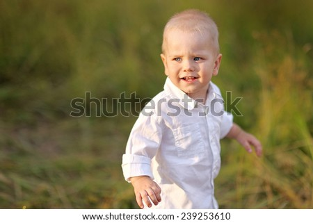 portrait of a Little boy playing in summer nature